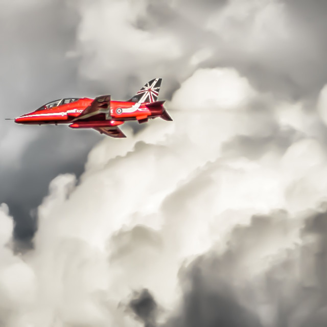 """""""Iconic Red Arrow Jet Fly Past"""" stock image"""