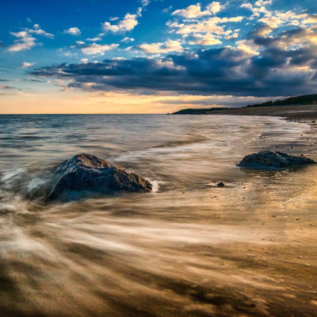 """Wet Feet And Sunset Rocks"" stock image"
