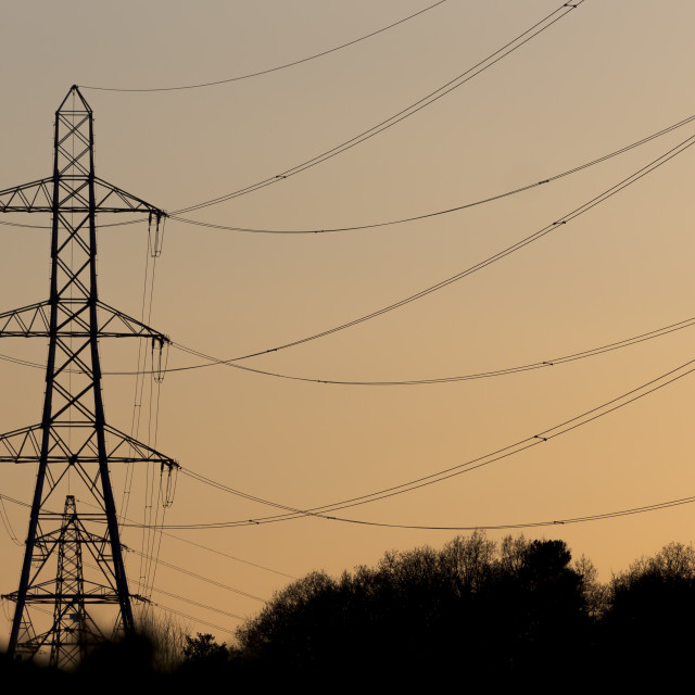 """Electricity Pylons in Setting Sun"" stock image"