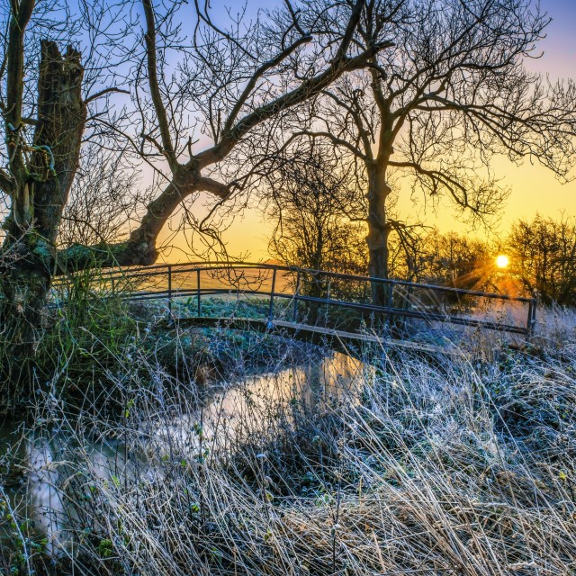 """Festive Old English Bridge Crossing Sunrise"" stock image"