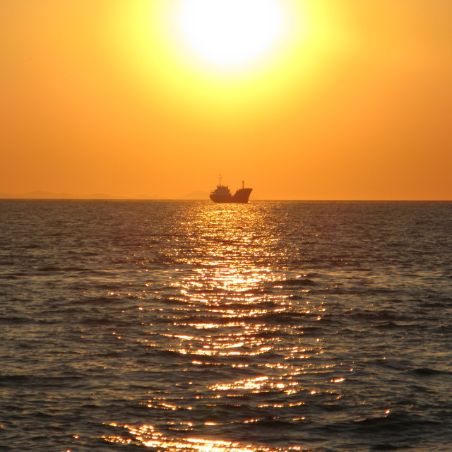 """""""Boat in sunset"""" stock image"""