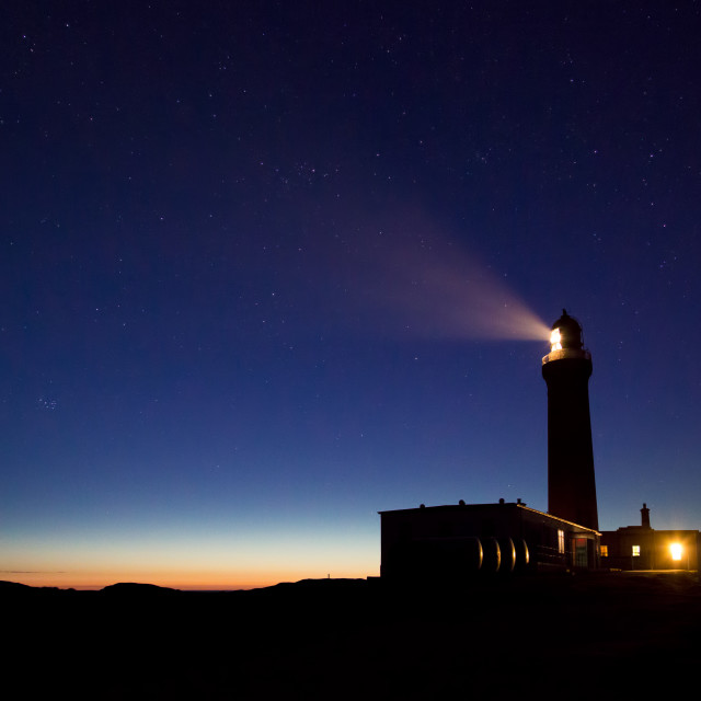 """Lighthouse under the stars"" stock image"
