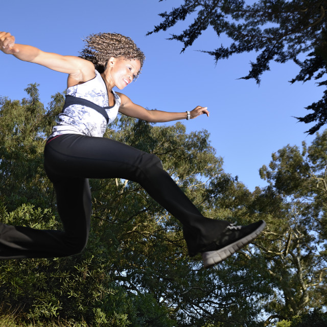 """""""Woman leaping"""" stock image"""