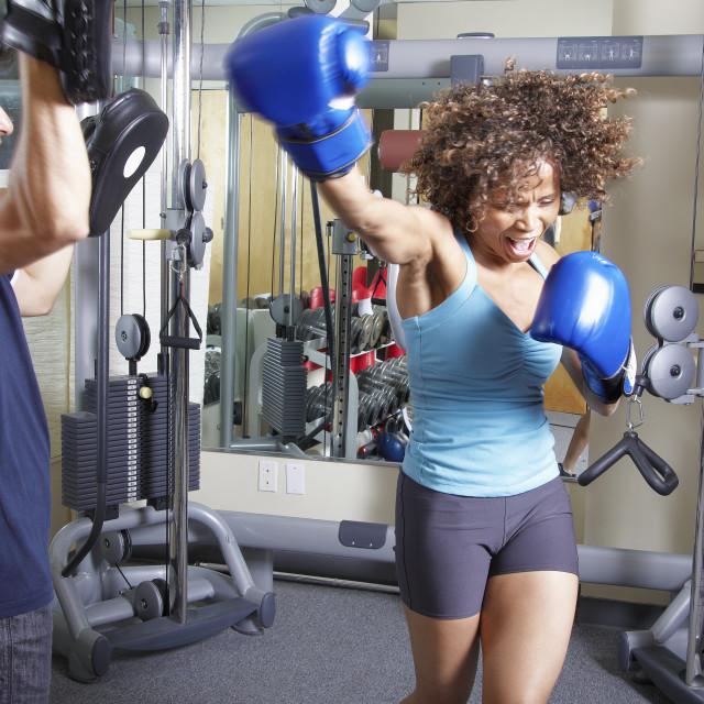"""Woman boxing training"" stock image"
