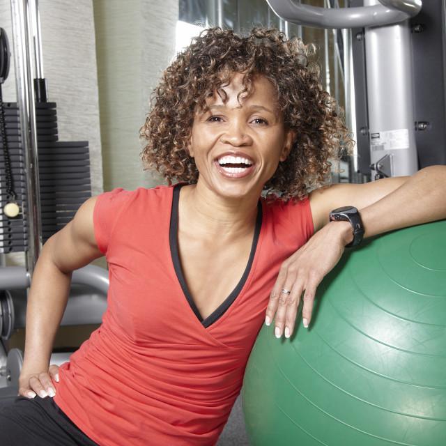 """Woman with gym ball"" stock image"