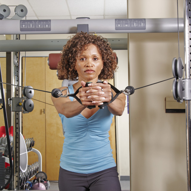 """""""Woman exercising in a gym"""" stock image"""