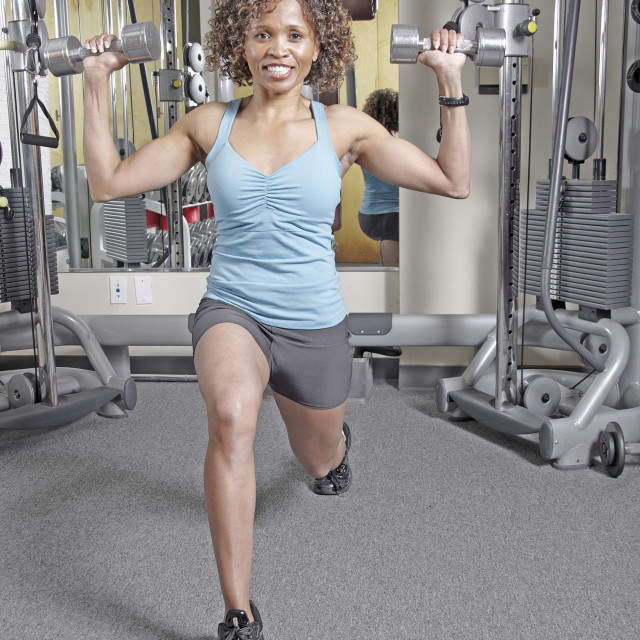 """""""Woman working out with Dumbbells"""" stock image"""