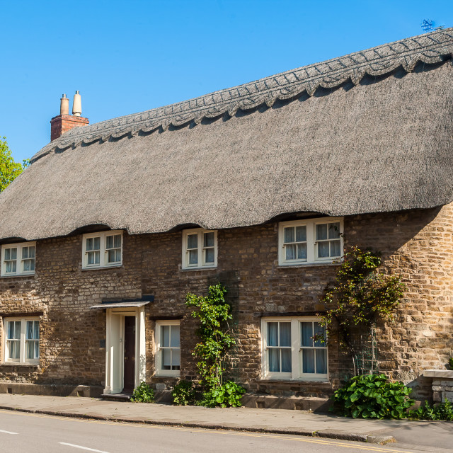 """300 Years Old Thatched Cottage"" stock image"