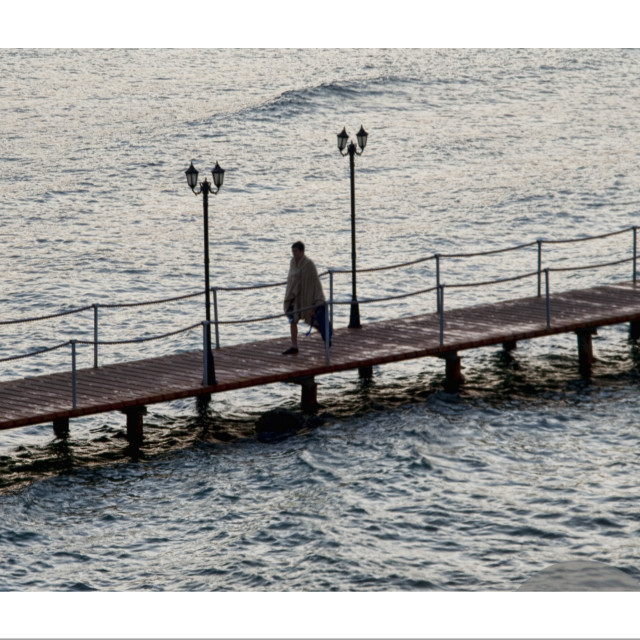 """man on a jetty"" stock image"