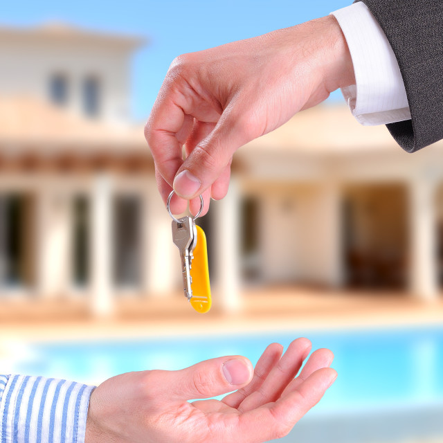 """Commercial agent giving keys to customer vertical composition"" stock image"