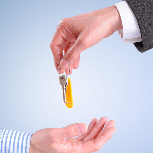"""Commercial agent giving keys to customer isolated vertical compo"" stock image"