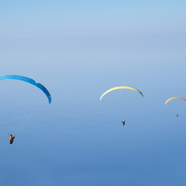 """Paragliders in the sky"" stock image"