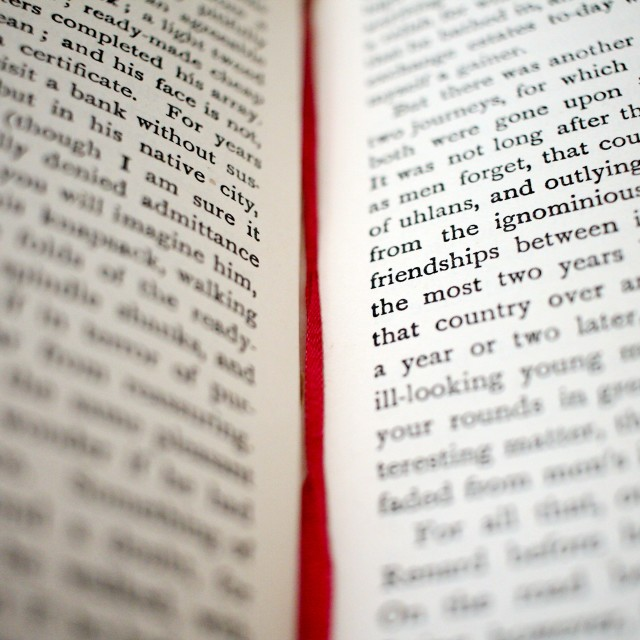 """Red ribbon in an old book"" stock image"