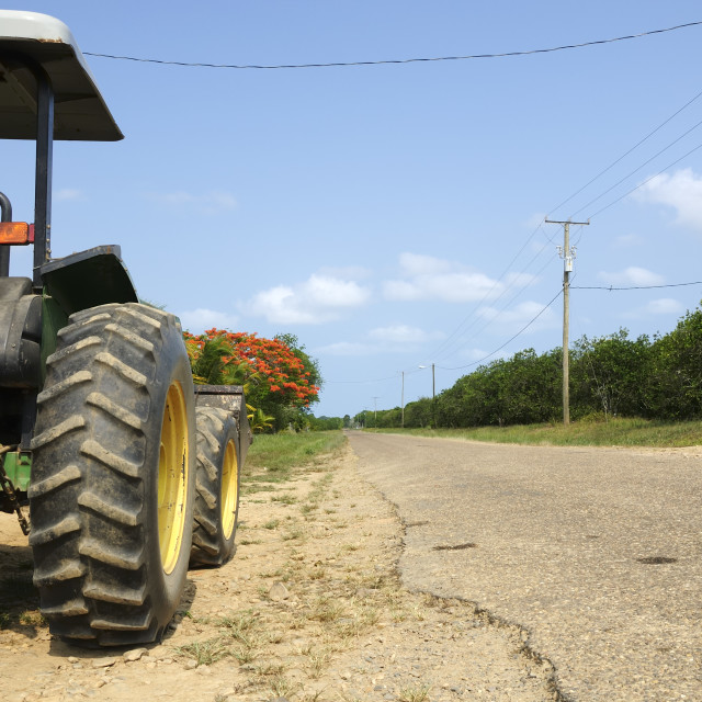 """Tractor at the side of a road"" stock image"