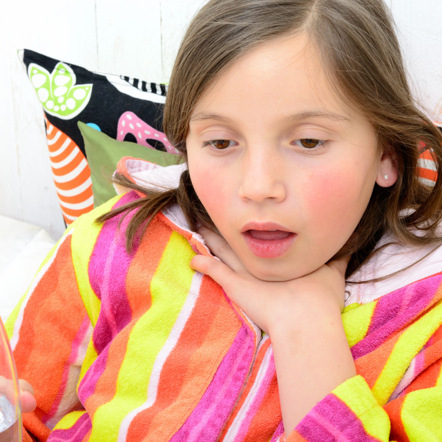 """a little girl has a sore throat"" stock image"