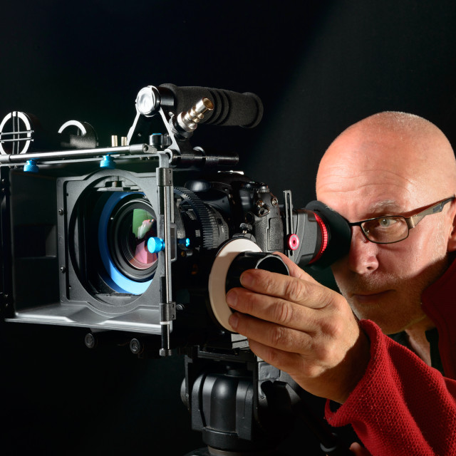 """man with a professional movie camera"" stock image"