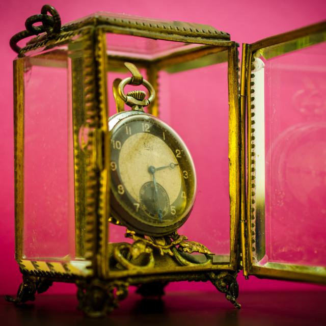"""Pocket watch, inside the glass box."" stock image"