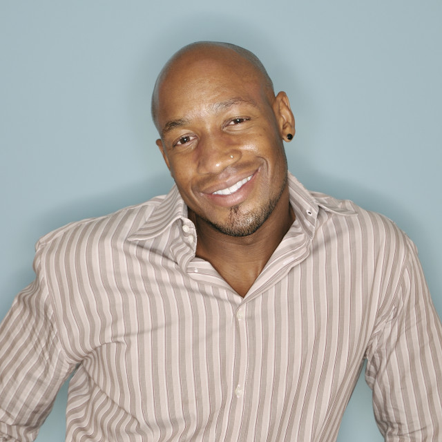 """Portrait of a smilimg African American man"" stock image"