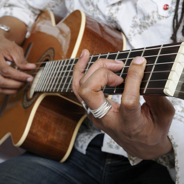 """""""Holding a guitar chord"""" stock image"""