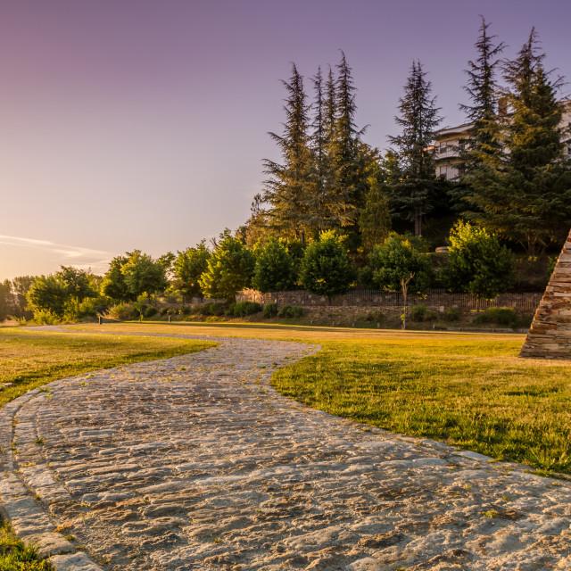 """Stone path passes in Mirandela garden."" stock image"