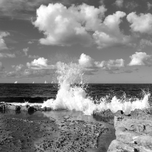 """Sea Wave Breaking Againts A Sea Shore - Black & White"" stock image"