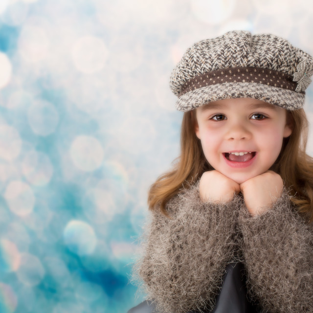 """Young girl looking happy"" stock image"