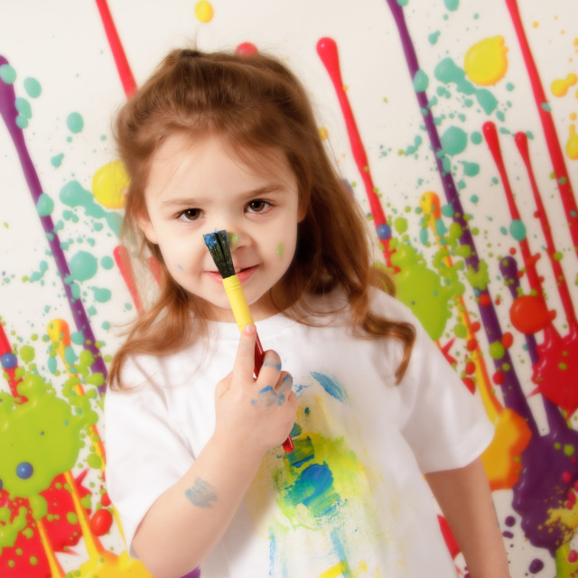 """""""Child playing with paints"""" stock image"""