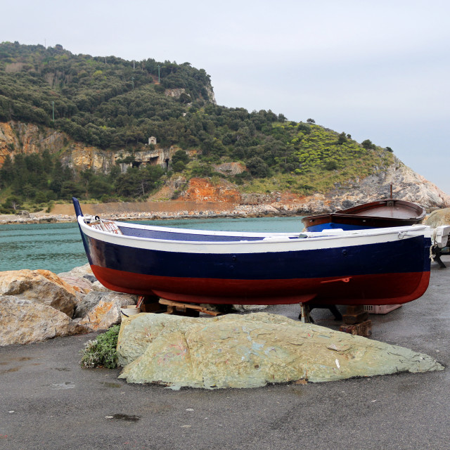 """Rowing boat on shore"" stock image"