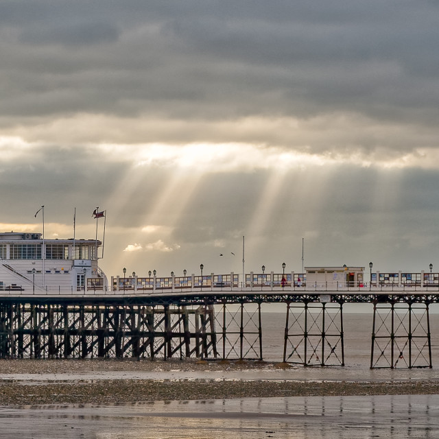 """Worthing pier touched by suns rays"" stock image"