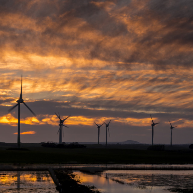 """Sunset over the Wind Farm."" stock image"