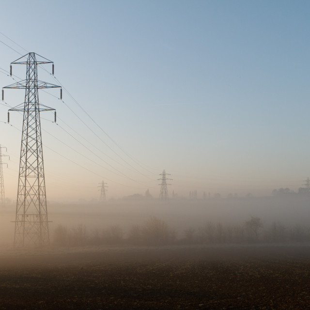 """Dawn mist and pylons"" stock image"