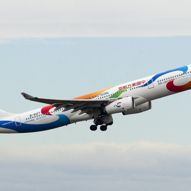 """A China Eastern Airbus A330 climbs out of Sydney."" stock image"