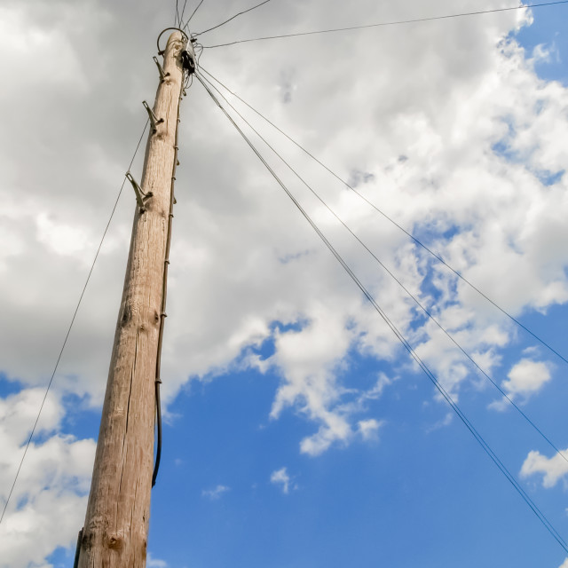 """utility pole and wires under a cloudy sky"" stock image"