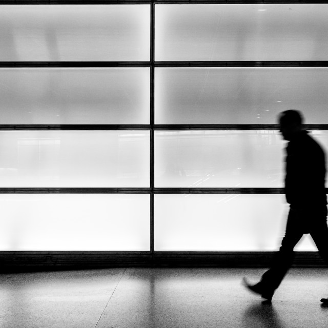 """""""Silhouette of a man walking by"""" stock image"""