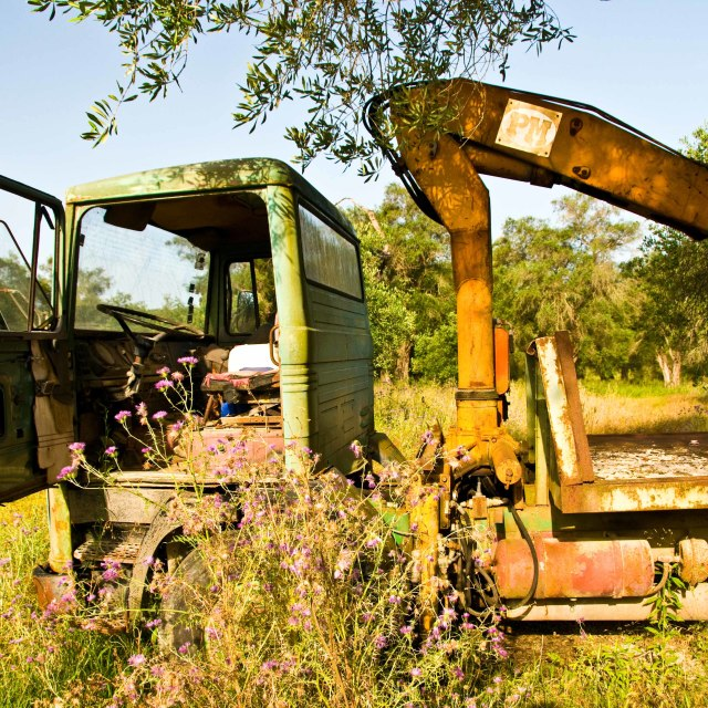 """An old lorry in meadow"" stock image"