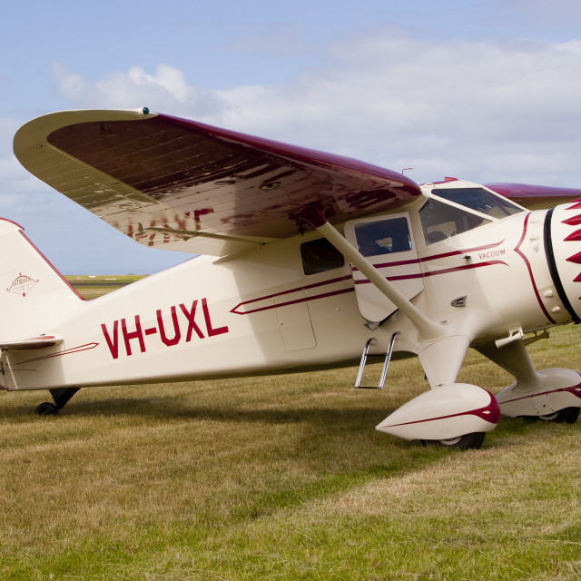 """""""Stinson Reliant VH-UXL at rest on Pt Cook airfield"""" stock image"""