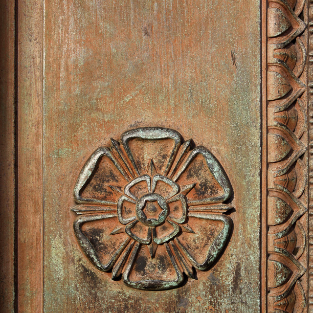 """Carved Tudor Rose on a vintage doorway"" stock image"