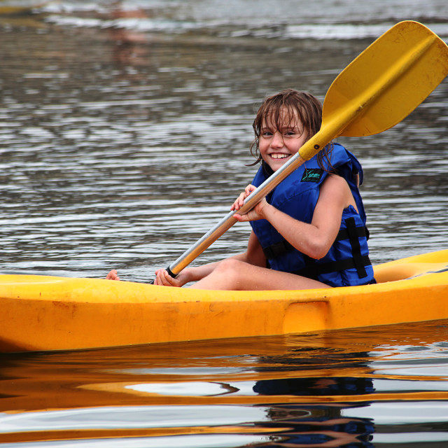 """Young girl in a canoe"" stock image"