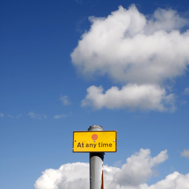 """""""At any time sign against a blue sky"""" stock image"""