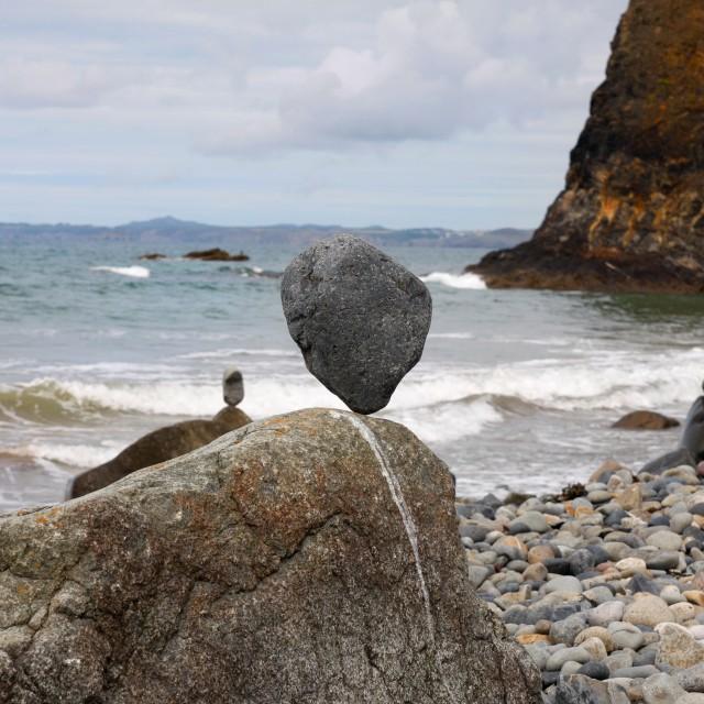 """Stones balanced on a pebble beach"" stock image"