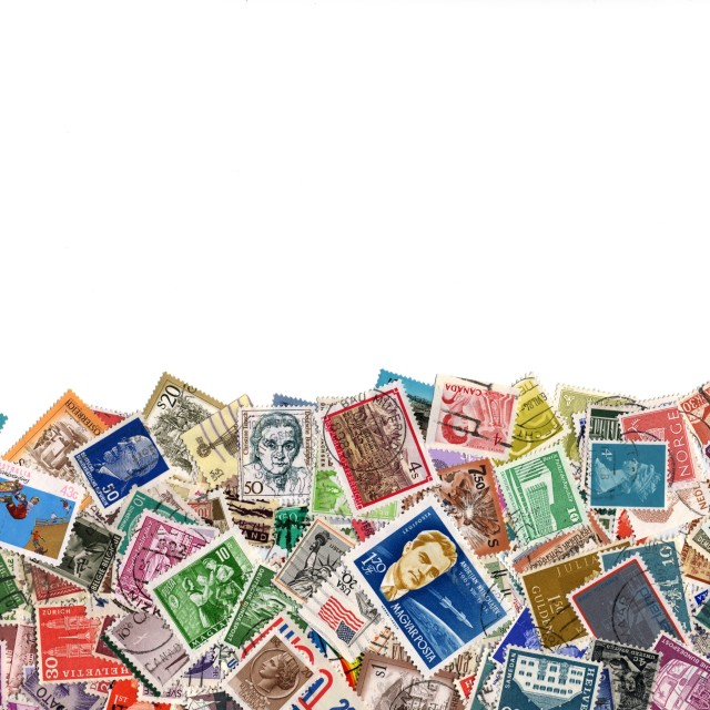 """Large amount of postage stamps isolated on white"" stock image"