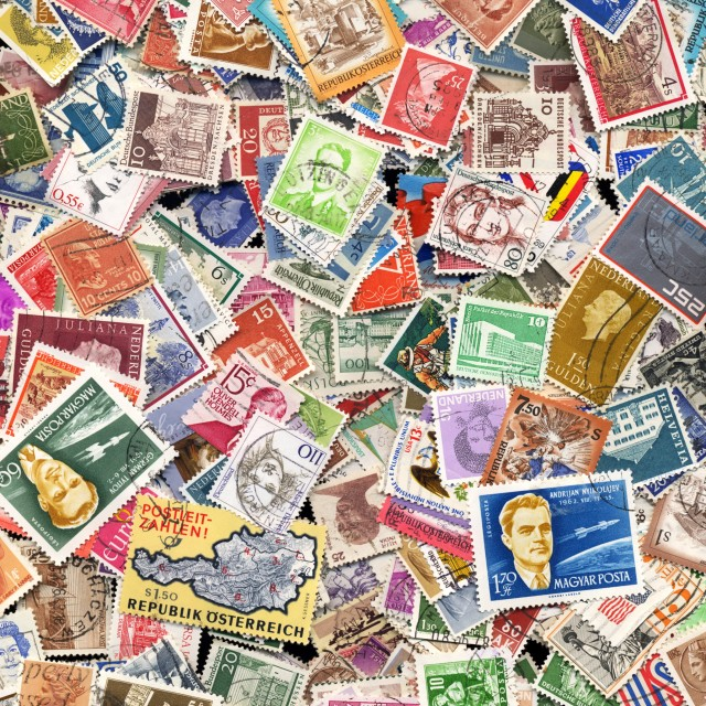 """Large pile of postage stamps"" stock image"