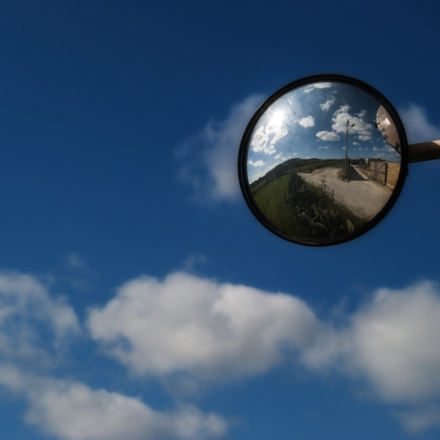 """reflection in the mirror over head"" stock image"