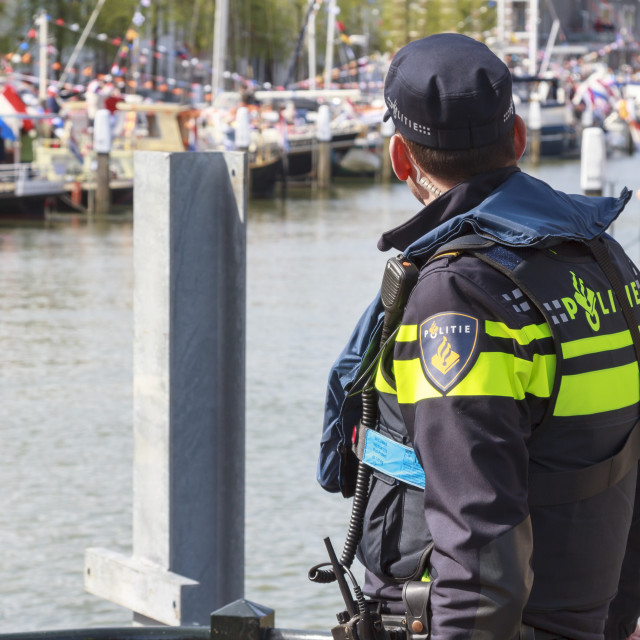 """""""Police officer keeping watch"""" stock image"""