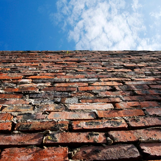 """""""Old brick wall and blue sky"""" stock image"""