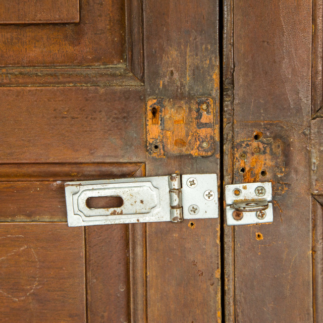 """Unlocked vintage wooden door from an old house"" stock image"