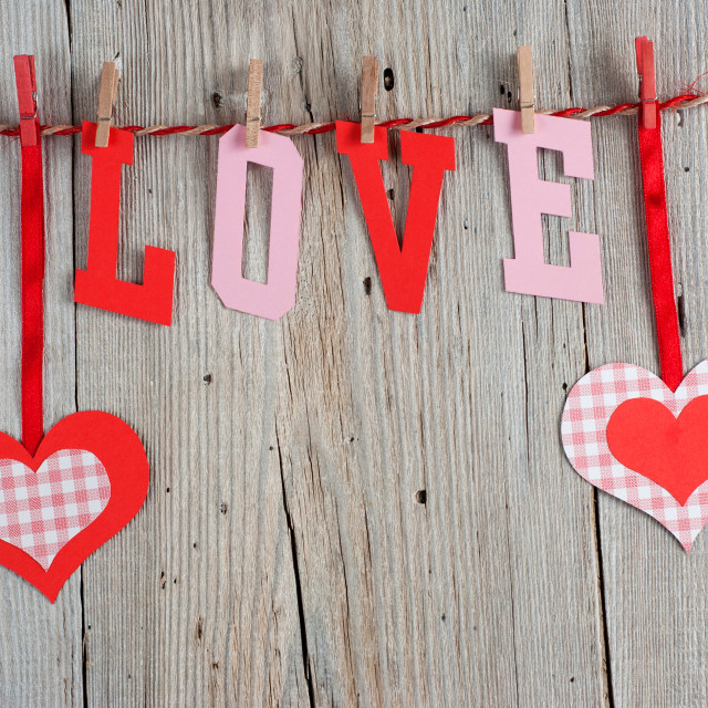 """Word LOVE and hearts"" stock image"