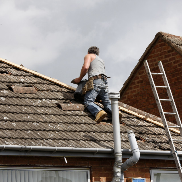 """Workman repairing a roof"" stock image"