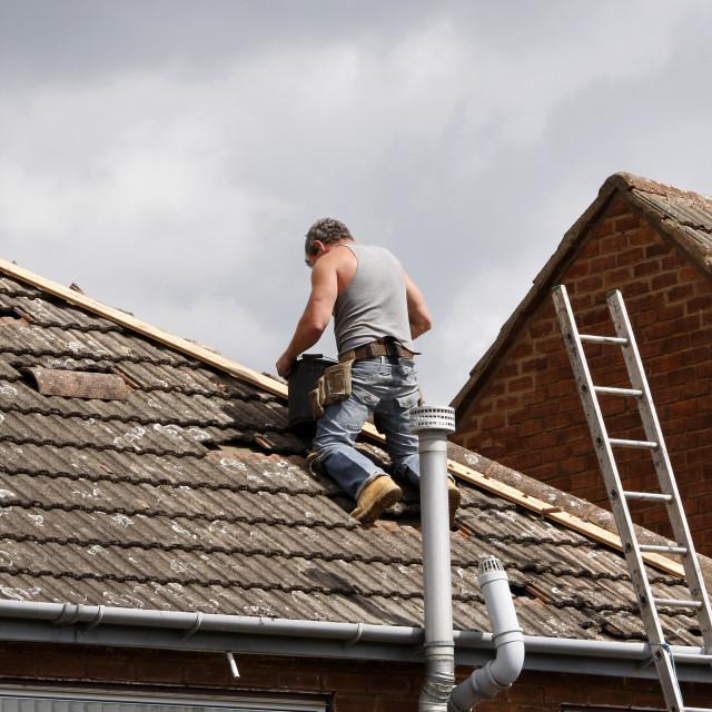 """Workman repairing a roof"" stock image"