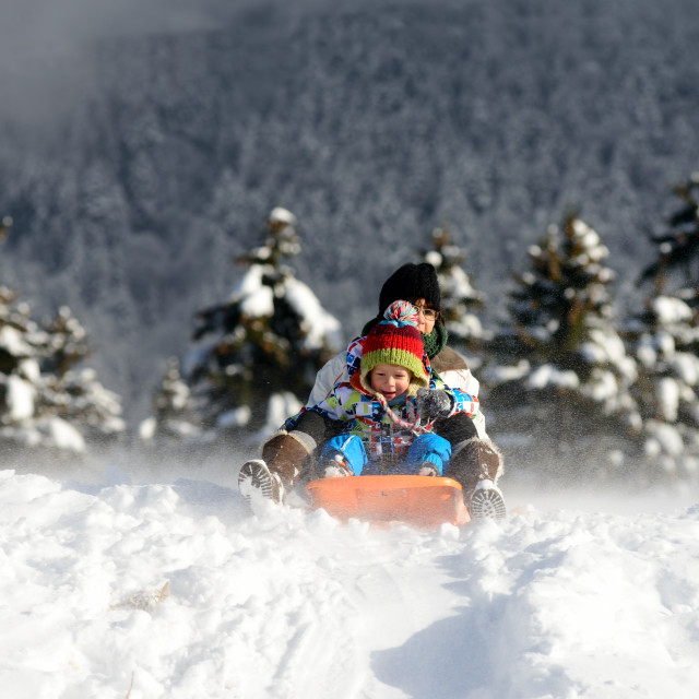 """a little boy sledging in the snow"" stock image"